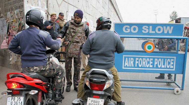 Pathankot: Security personnel check IAF employees near the Indian Air Force base in Pathankot during the third day of the operations against militants on Monday. PTI Photo (PTI1_4_2016_000067B)